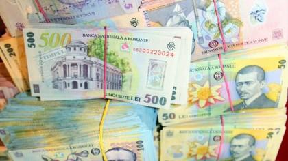 Se dau bani pentru români. E oficial, sumele intră joi pe carduri